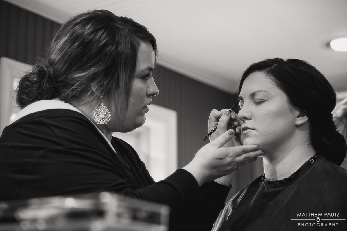 bride getting makeup ready for wedding