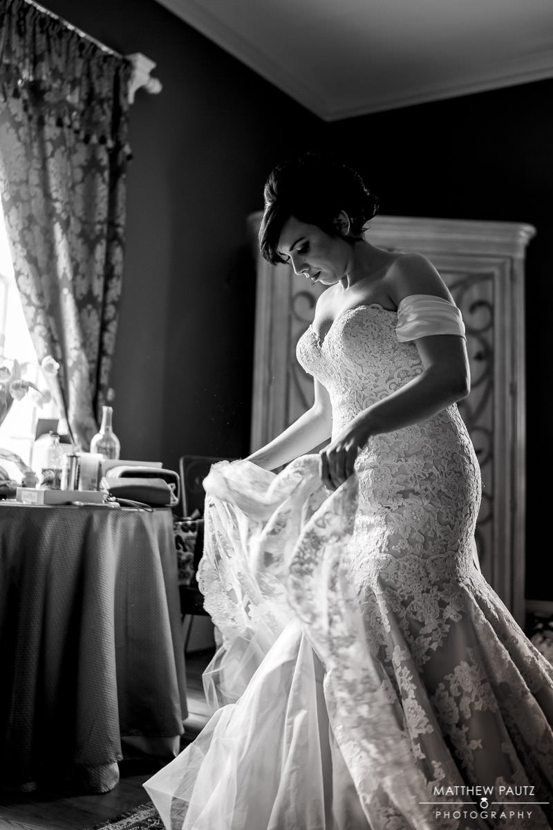 Bride putting on wedding dress at Duncan Estate