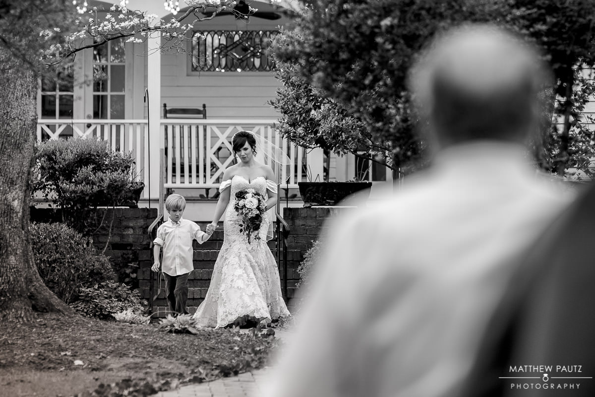 Bride walking down aisle at outdoor wedding
