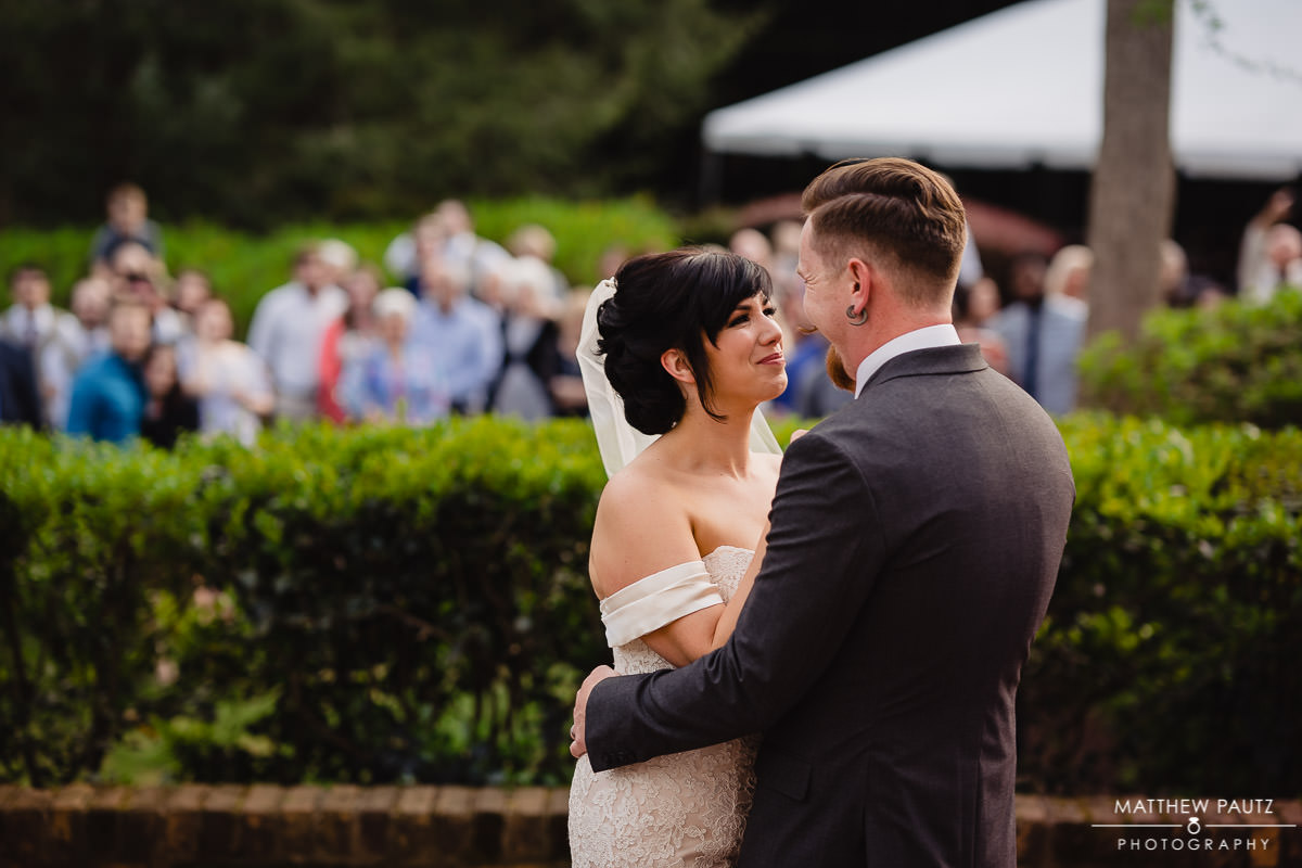 Bride and groom's first dance on patio at Duncan Estate