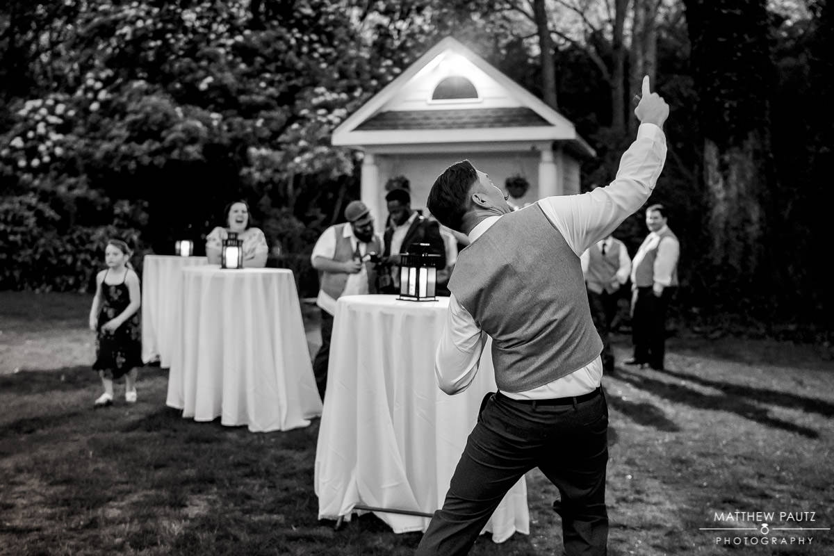 groom dancing outside at wedding reception