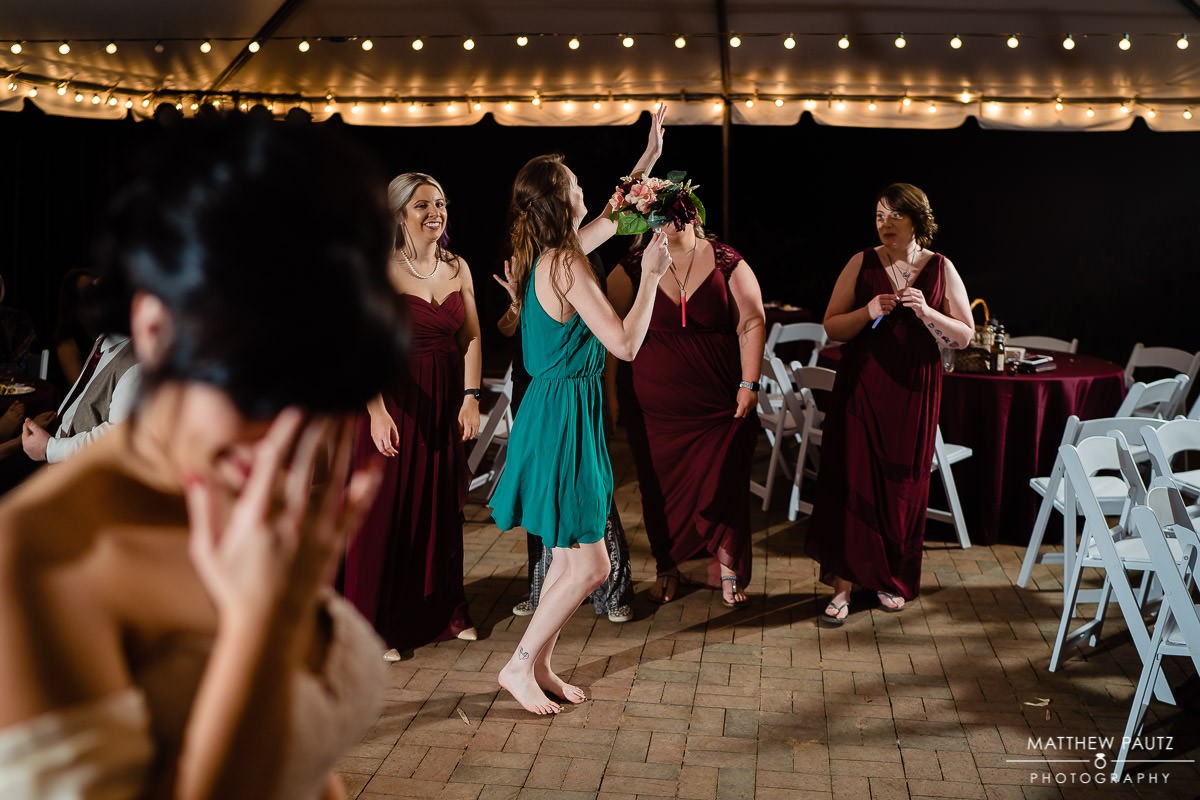 bridesmaid getting excited after catching wedding bouquet