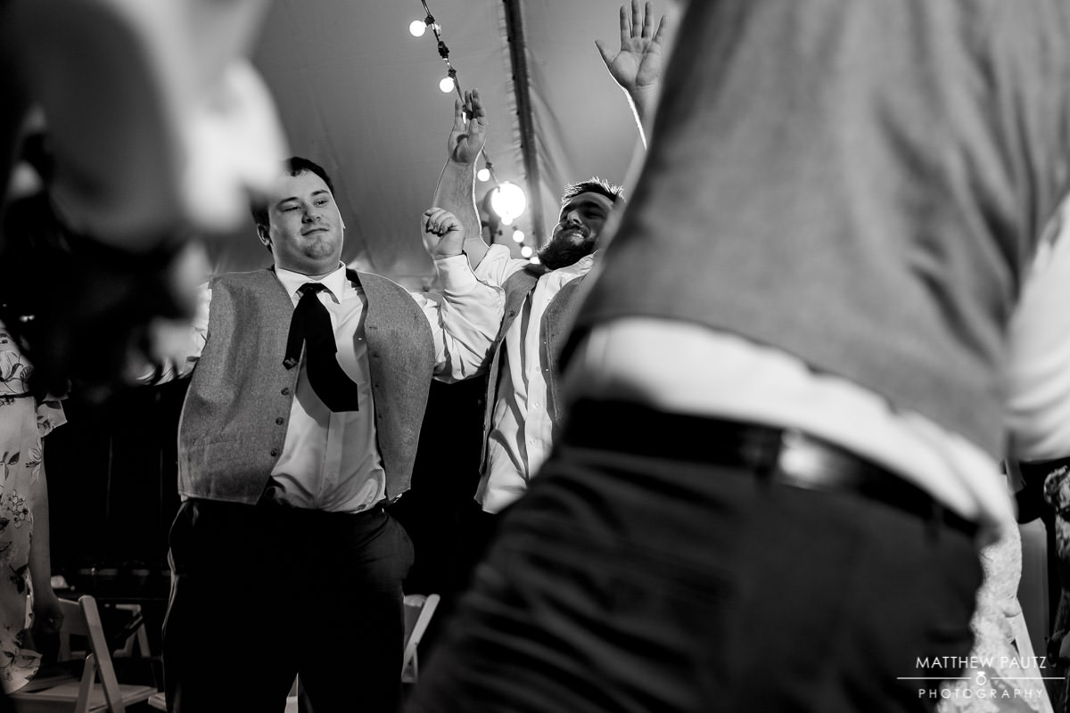 groomsmen having fun and celebrating after wedding at duncan estate