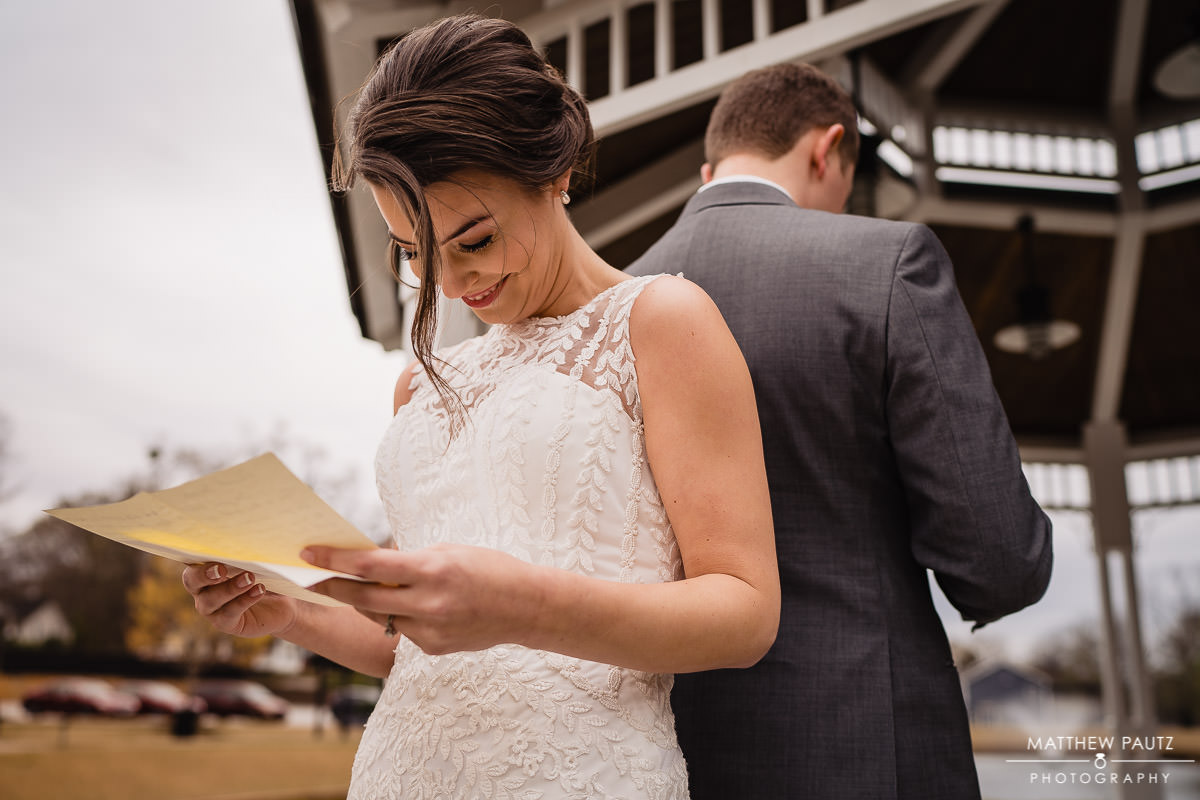 bride and groom reading letters written to each other