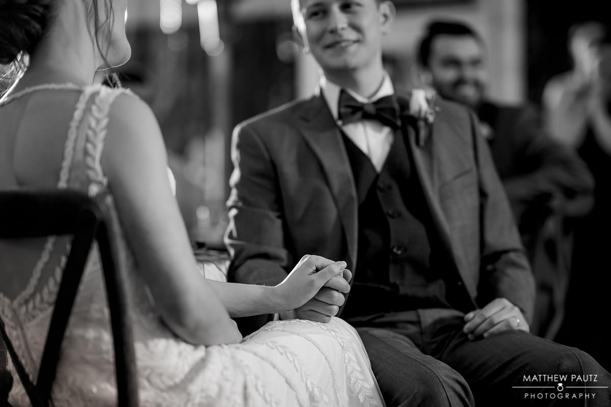 groom looking at bride during reception toasts