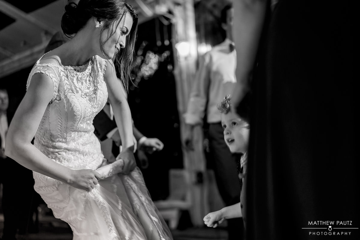 bride dancing with child at wedding reception