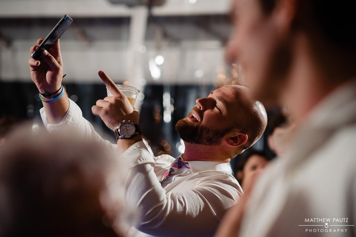 wedding guest taking selfie