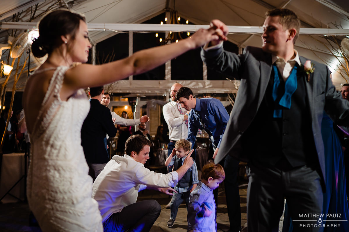 several guests dancing at once at wedding reception