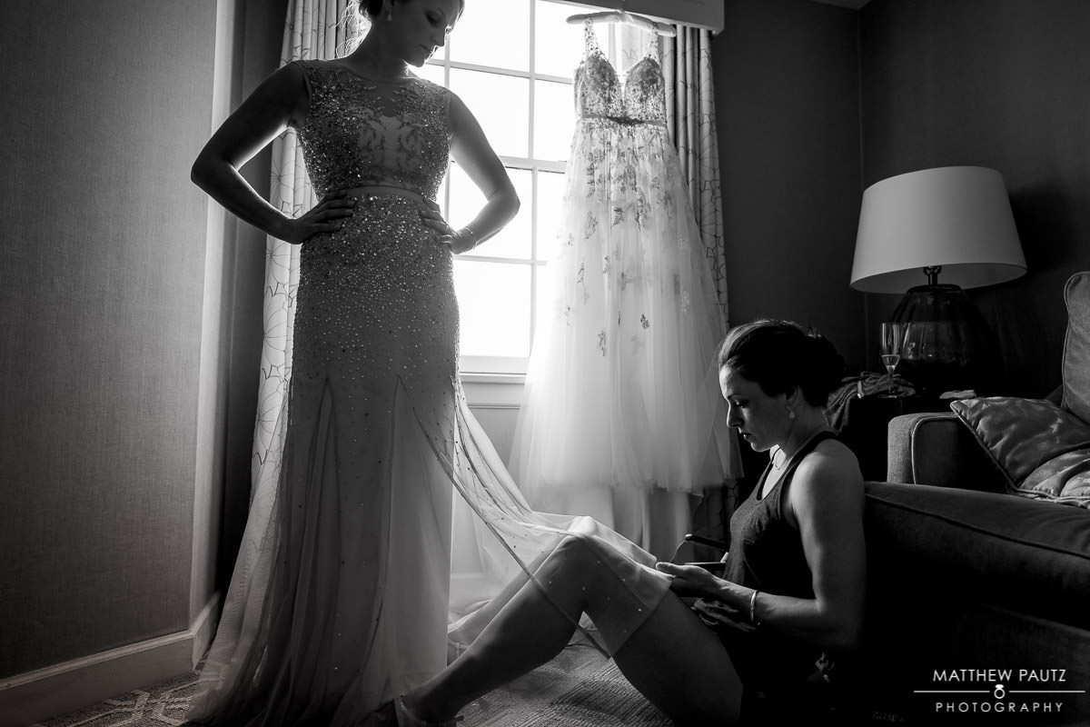 bridesmaids getting dressed before wedding ceremony