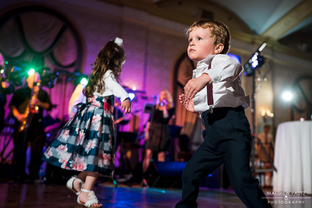 child dancing intensely at wedding reception