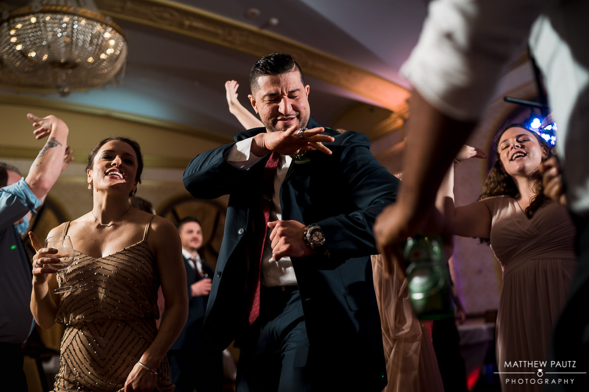 groomsman having fun at wedding reception