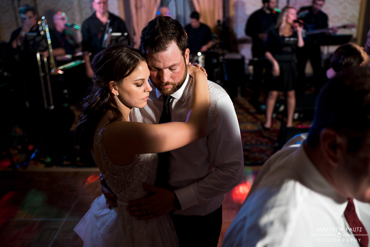 bride and groom dancing together at westin poinsett wedding reception