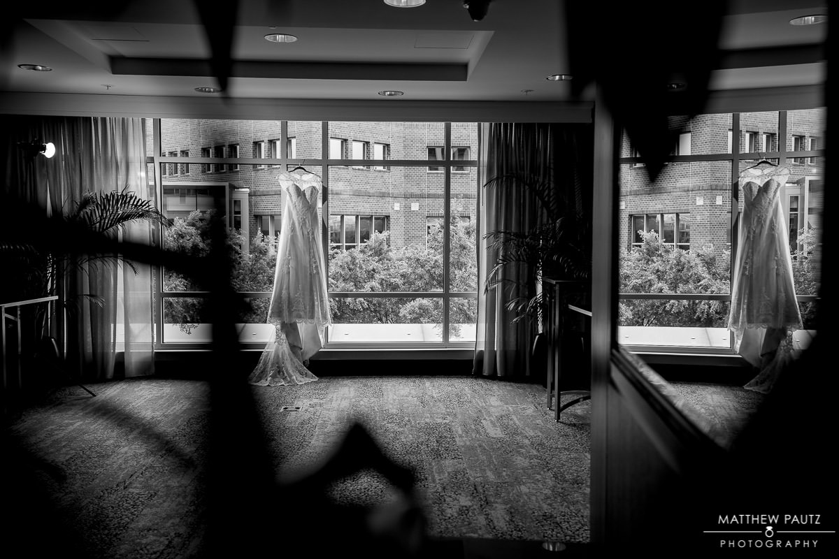 wedding dress hanging in hotel lobby