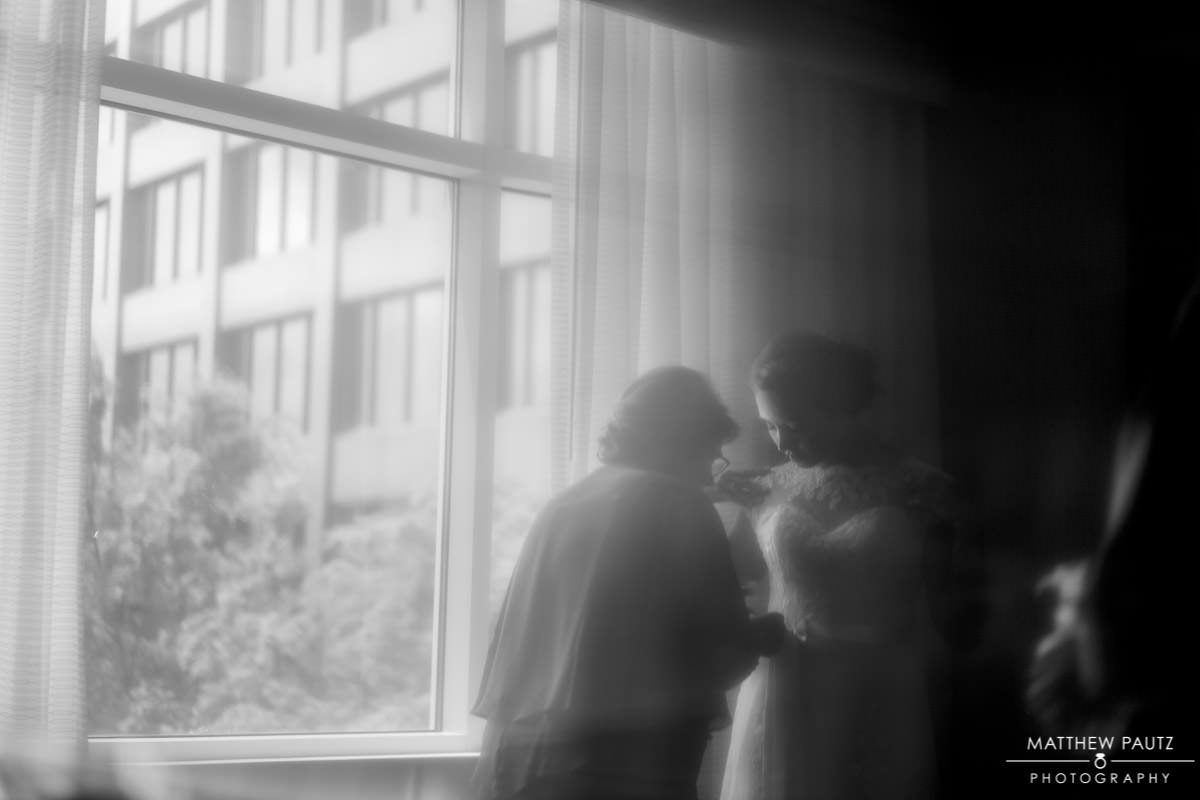 reflection of bride getting ready in hotel room