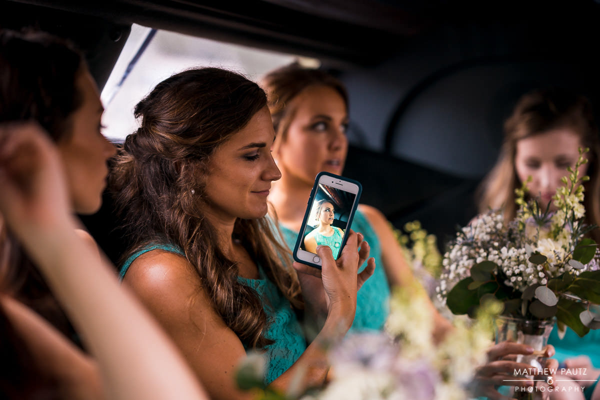 bridesmaids having fun in limo ride to ceremony location