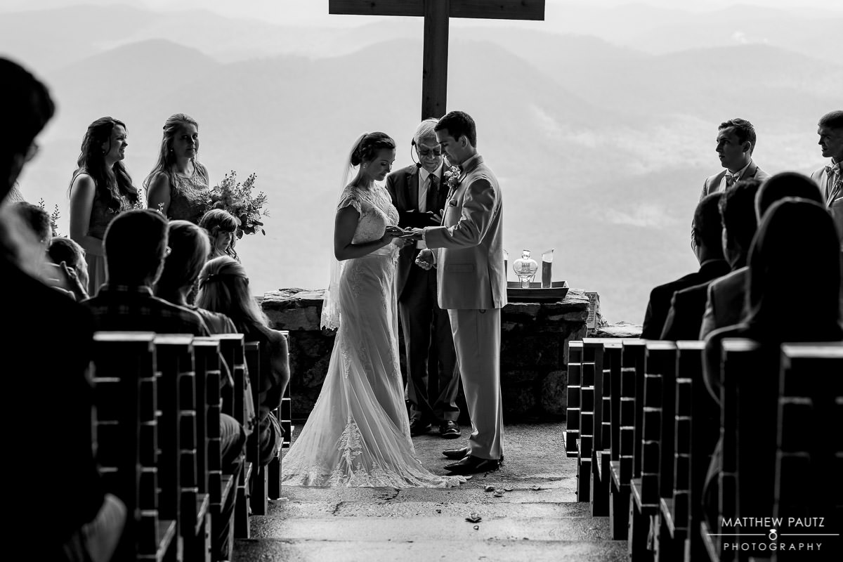 bride and groom exchanging rings at pretty place wedding ceremony