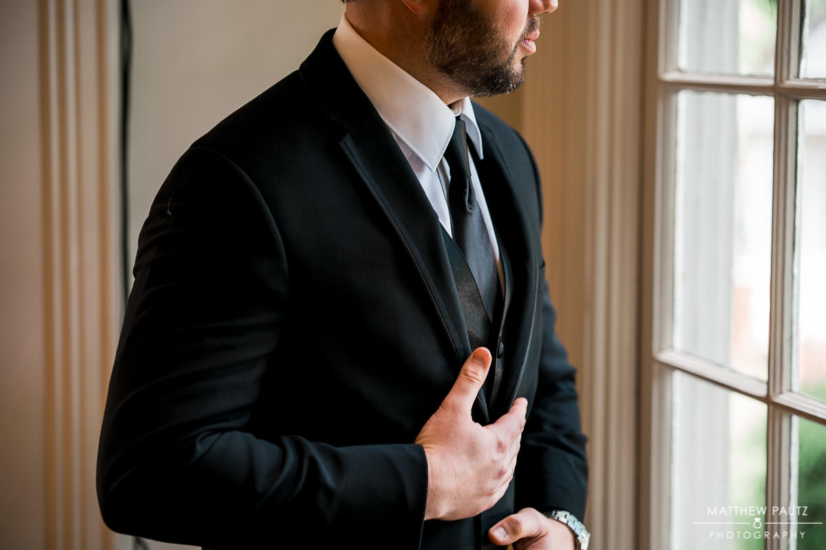 Groom preparing for wedding ceremony at The Duncan Estate