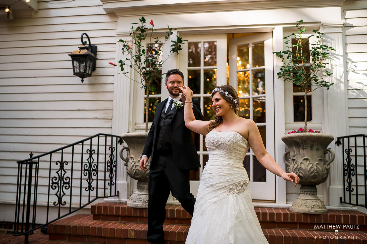 bride and groom dancing on porch at the duncan estate