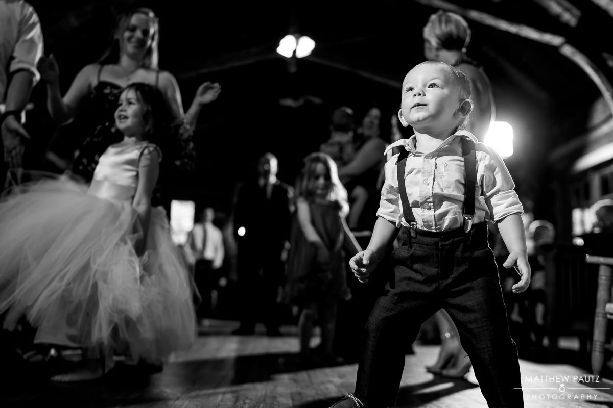 small child dancing at mountain lodge wedding