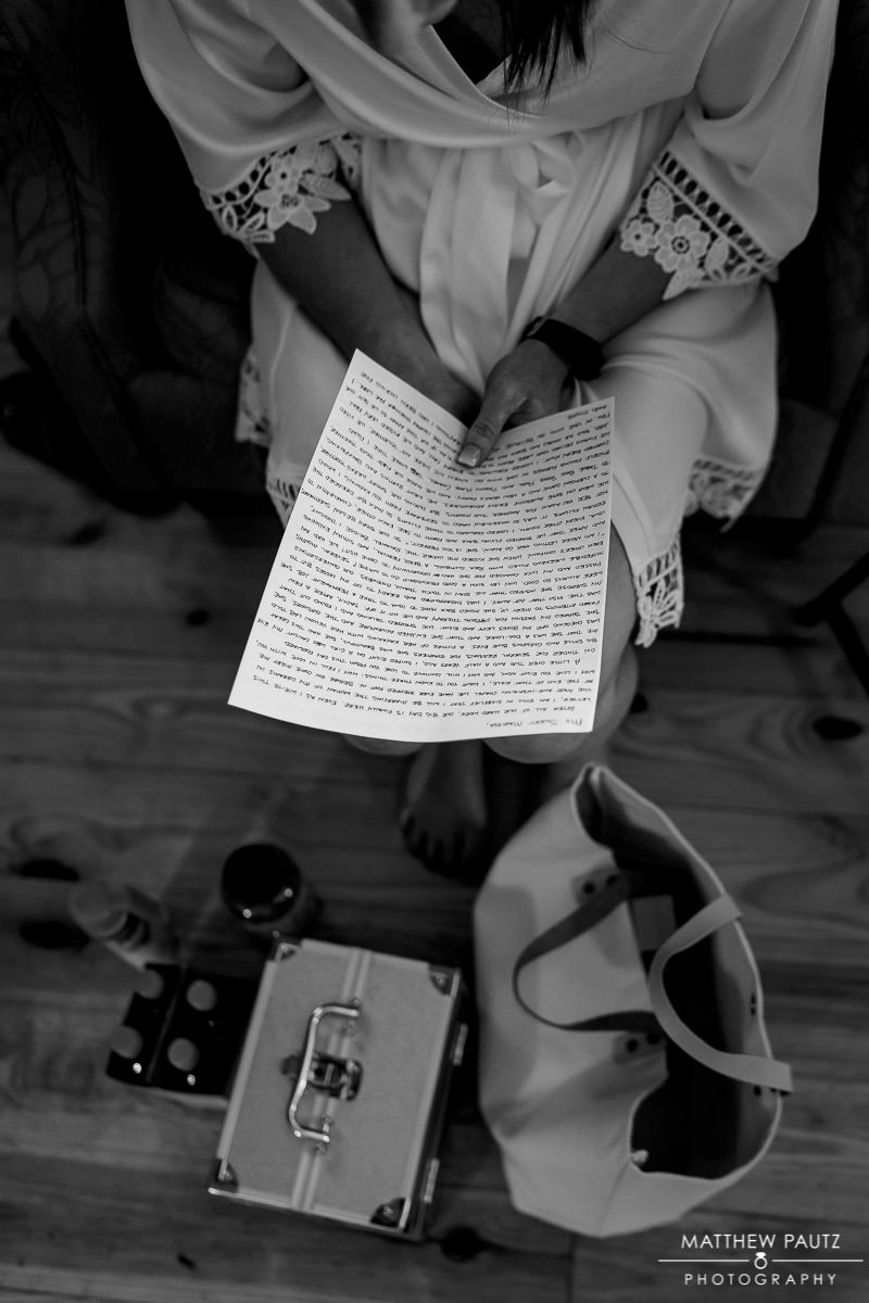 Bride reading letter from future husband on wedding day