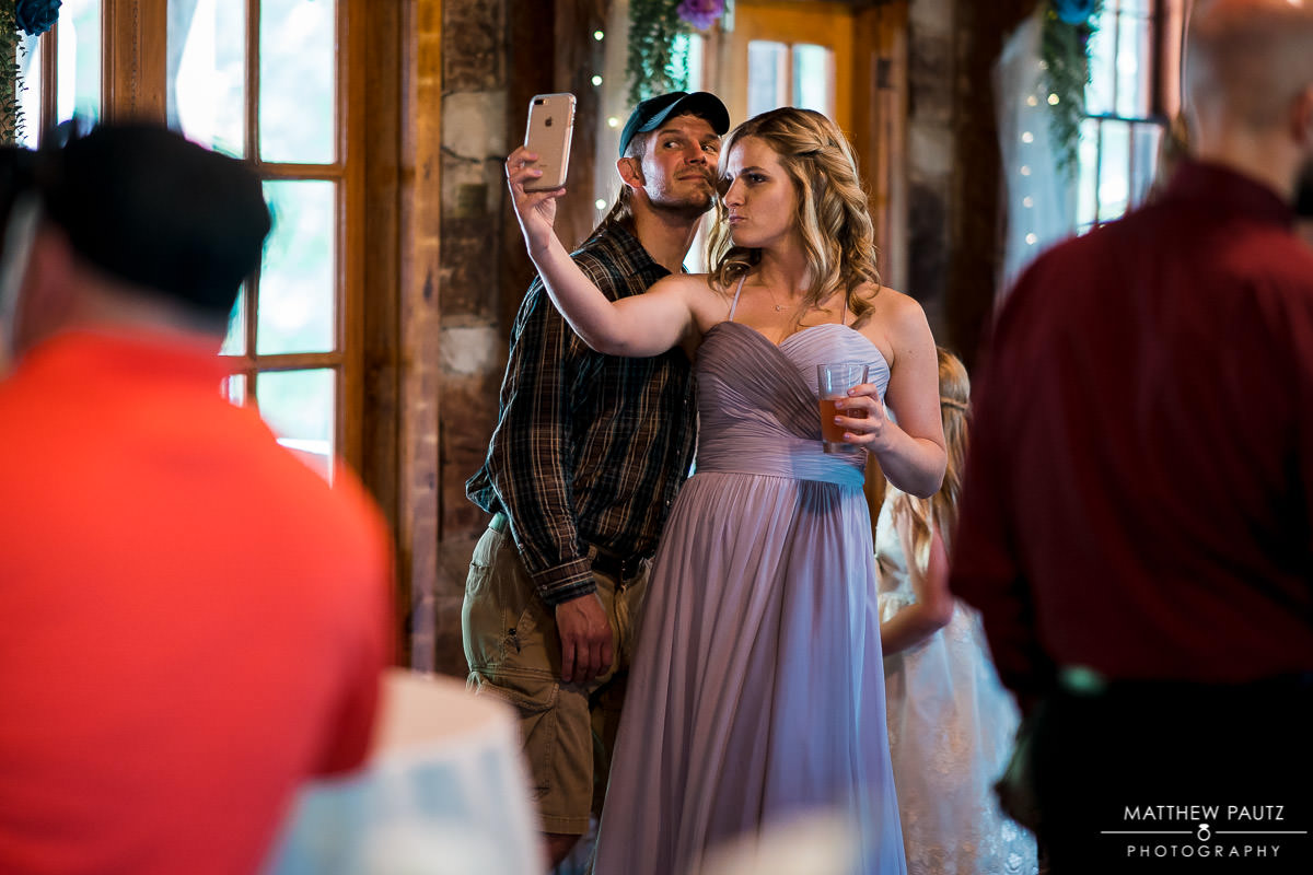 bridesmaid taking selfie at reception