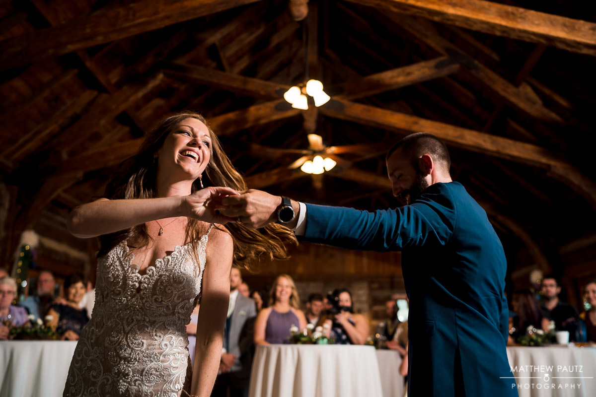 groom twirling bride during first dance at blue ridge mountain wedding