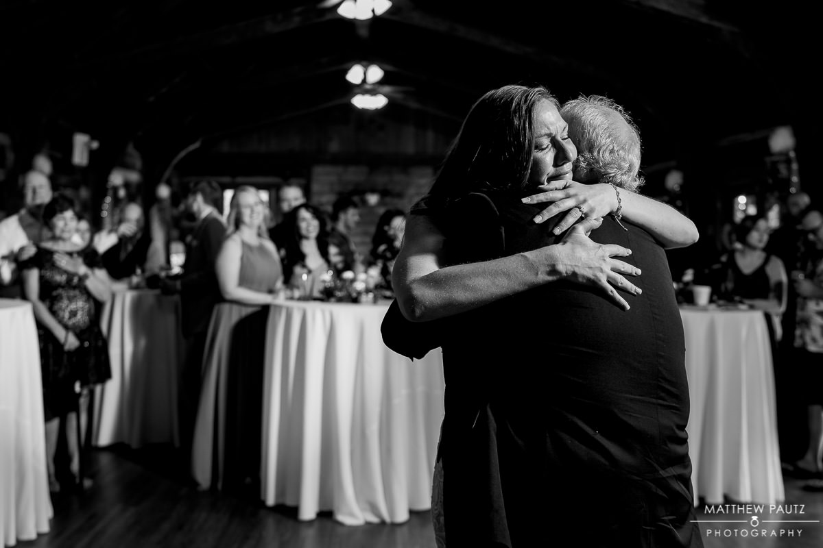 bride hugging father during first dance