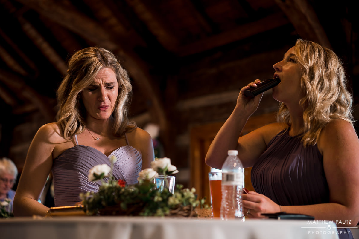 bridesmaids taking shots of alcohol at wedding reception