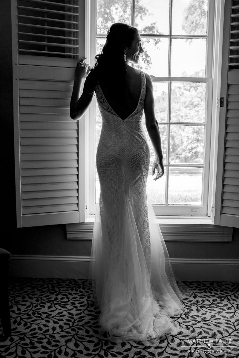 bride looking out window at country club