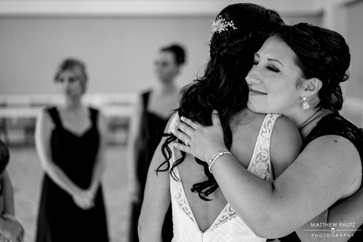 bridesmaid hugging bride before wedding