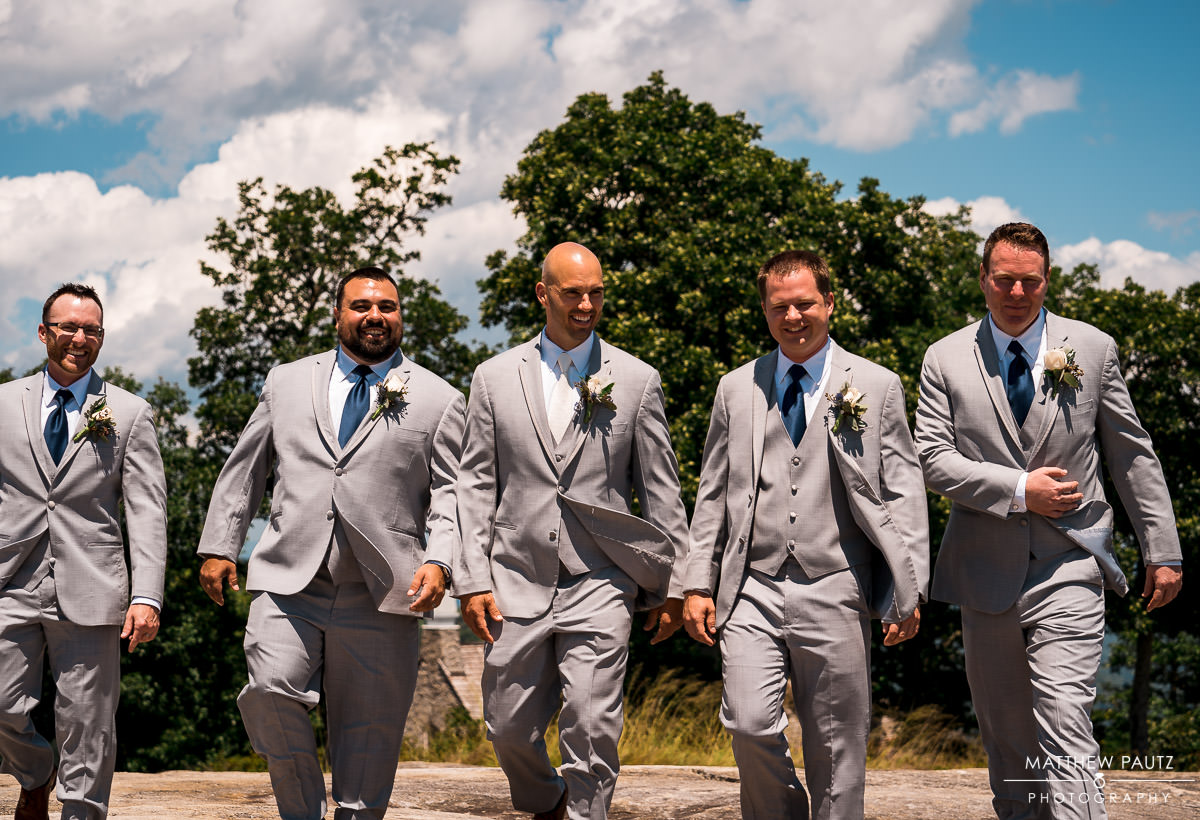 groomsmen walking outside after wedding