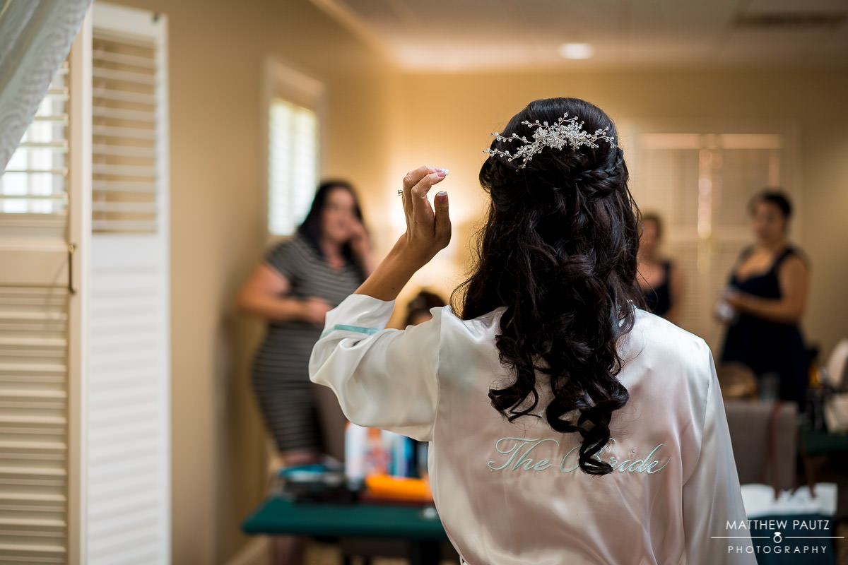 bride showing off hair to bridesmaids before wedding