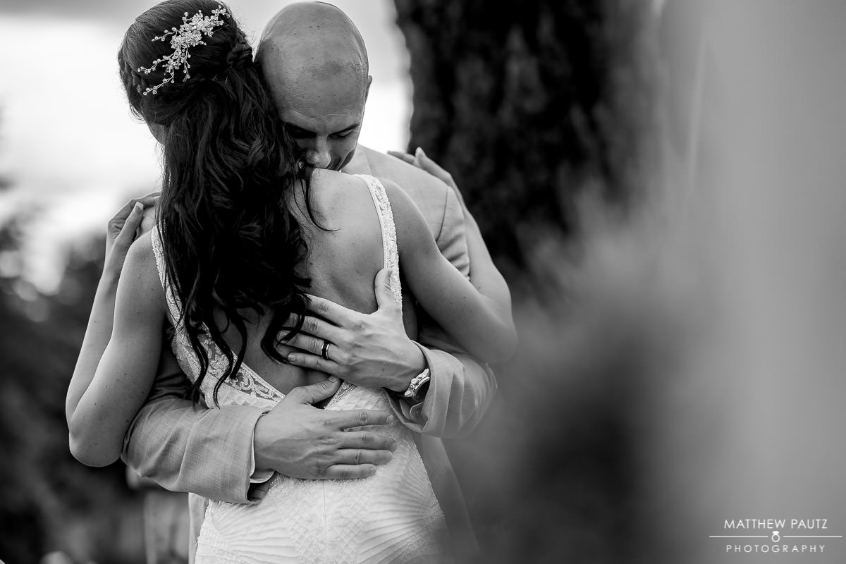 bride and groom hugging after wedding