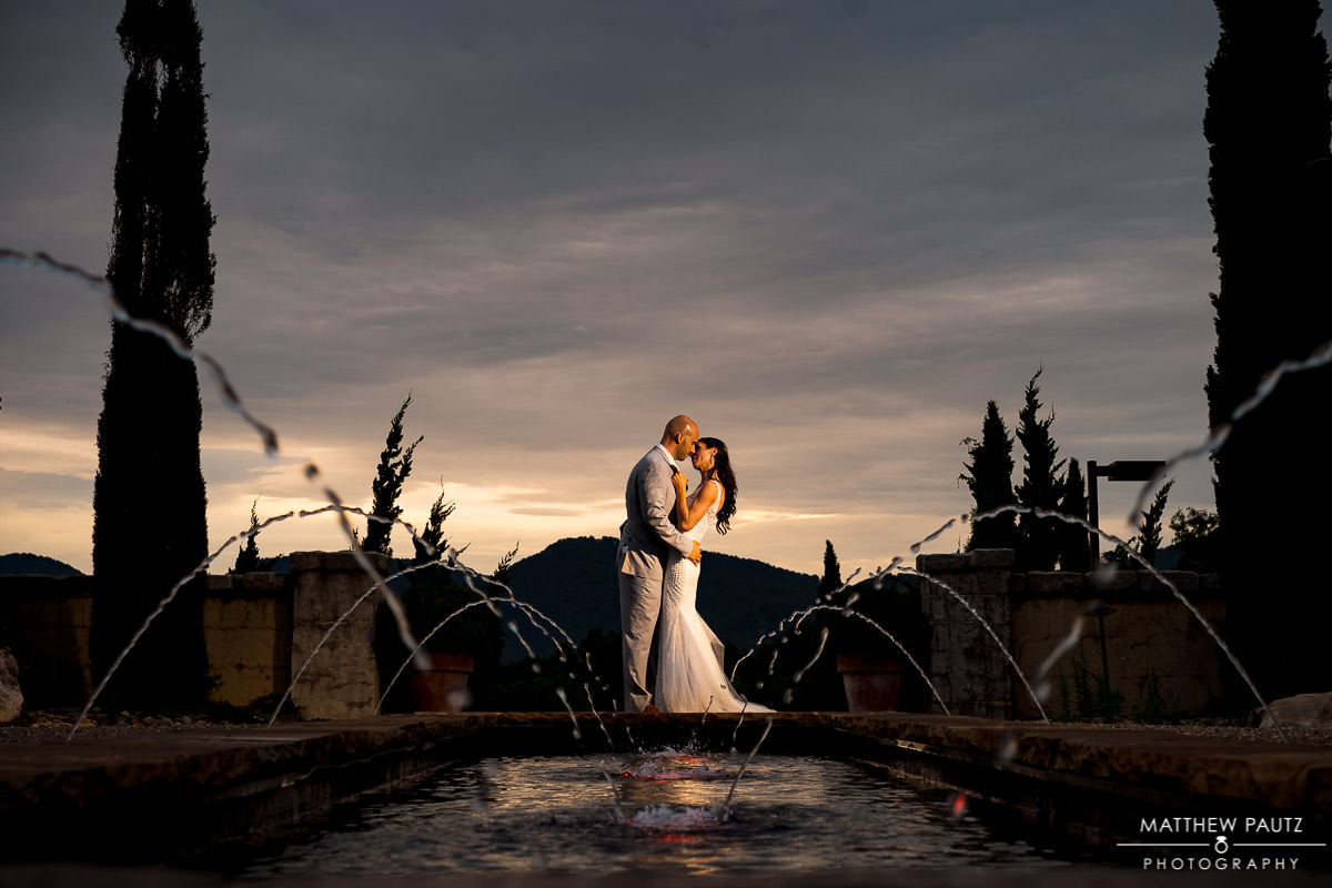 bride and groom hugging at hotel domestique at sunset