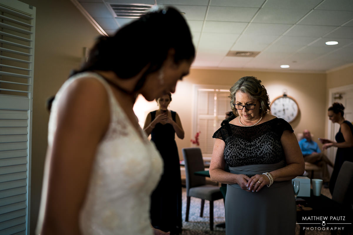 mother of the bride admiring bride after getting dressed