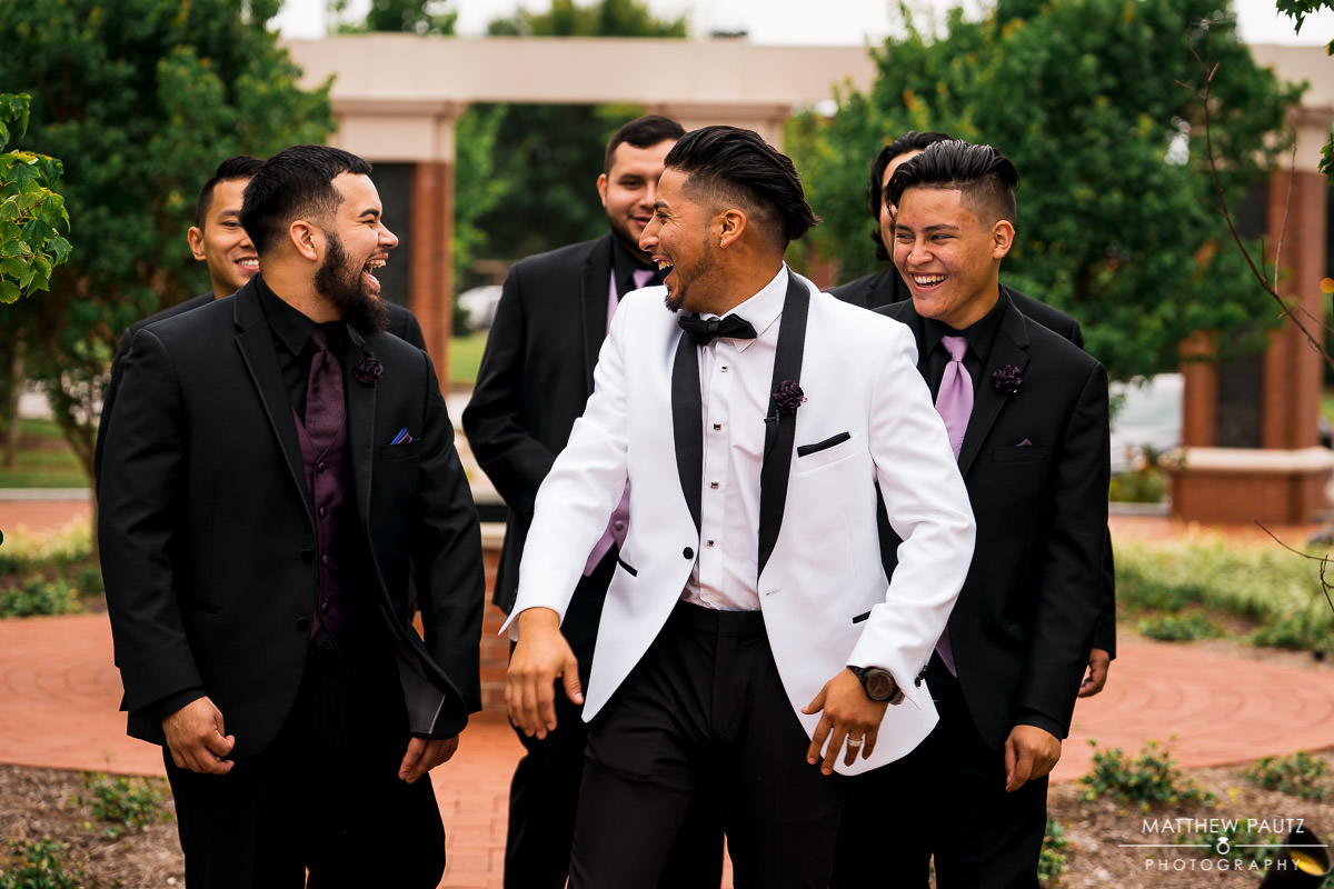 groomsmen walking and laughing after wedding ceremony