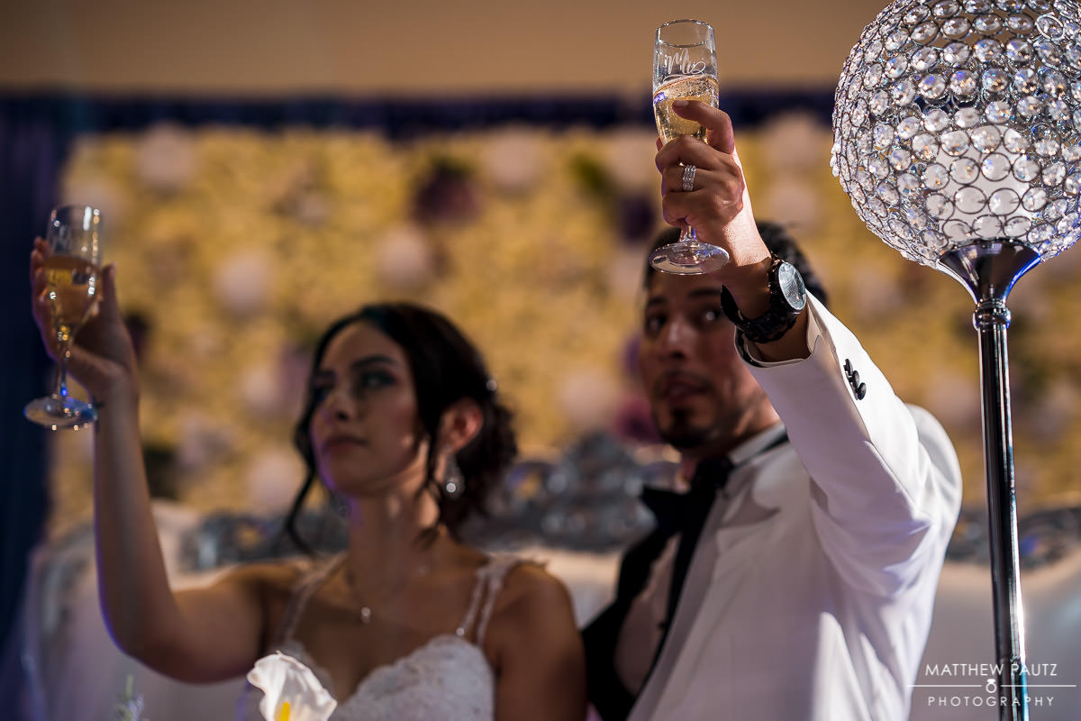 Bride and groom reacting to wedding toasts