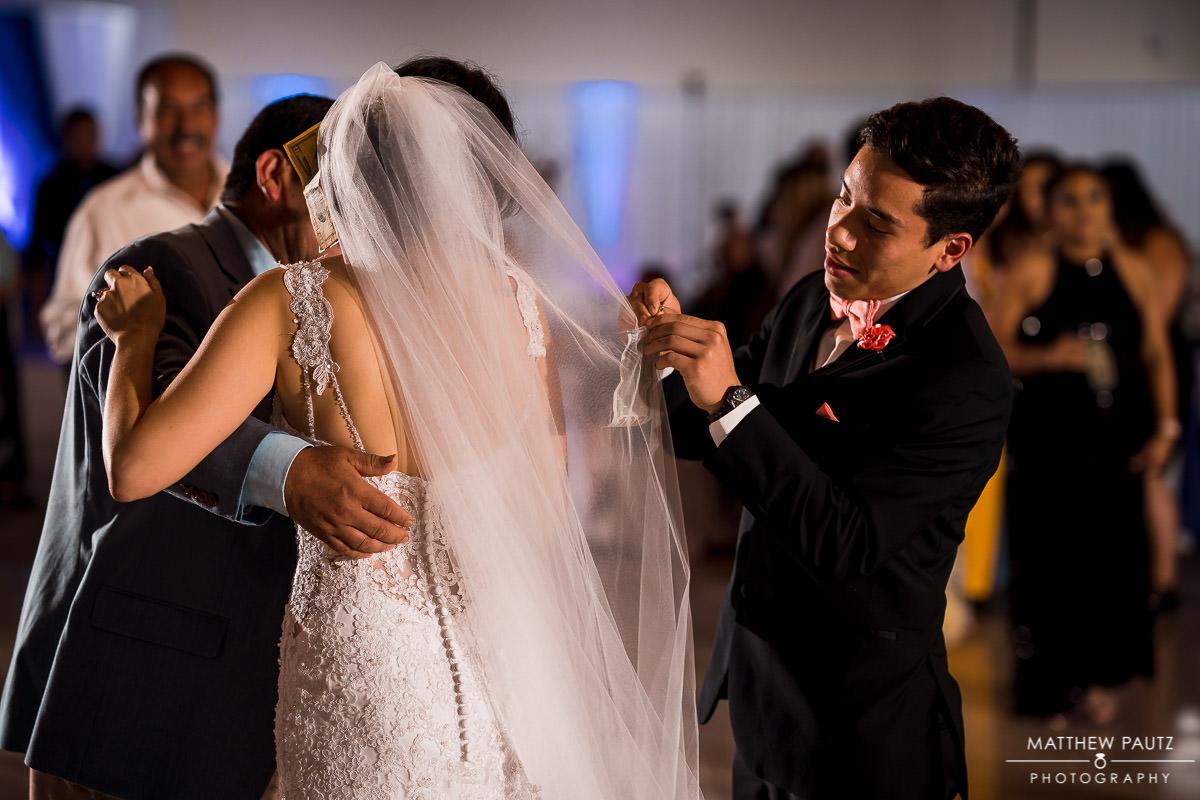 Traditional hispanic money dance at wedding reception