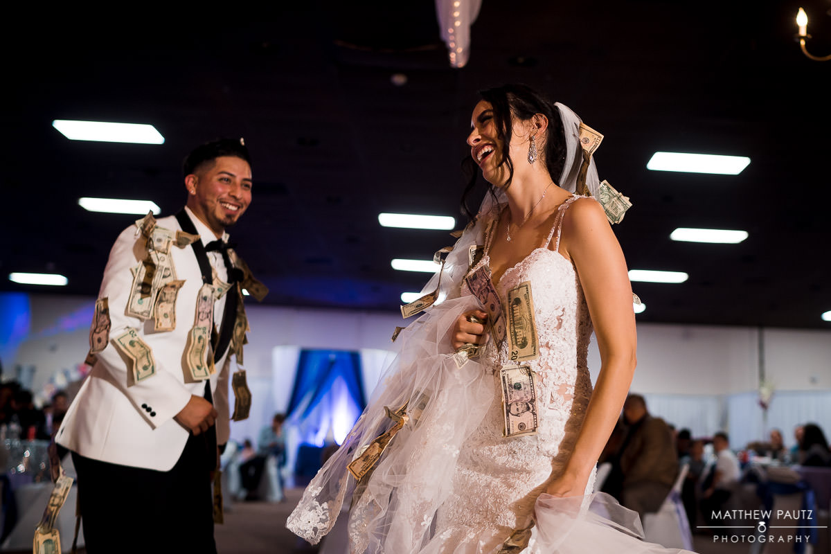 bride and groom money dance at wedding reception