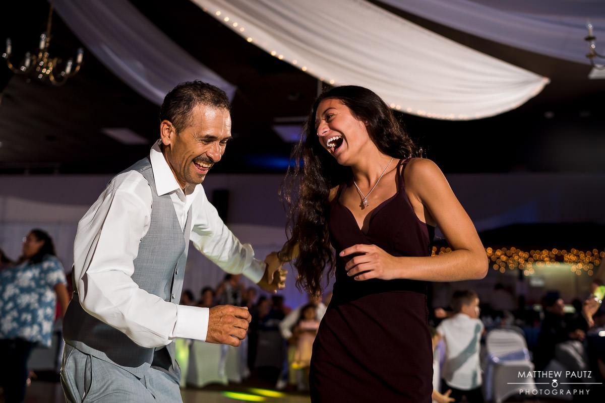 dancing guests at wedding reception