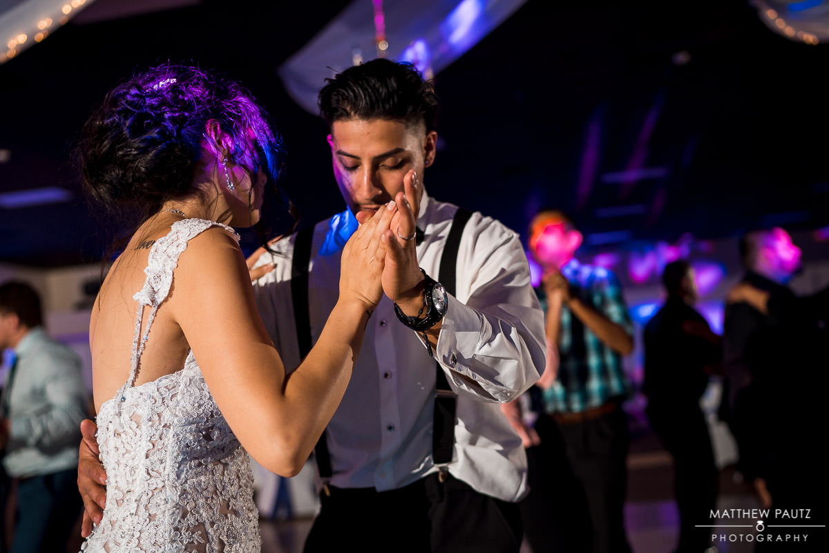 bride and groom dancing together at the greenville shrine club