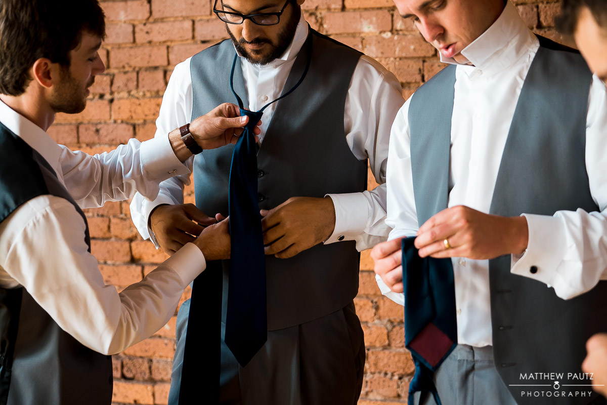 groomsmen getting dressed at Indigo Hall, Spartanburg