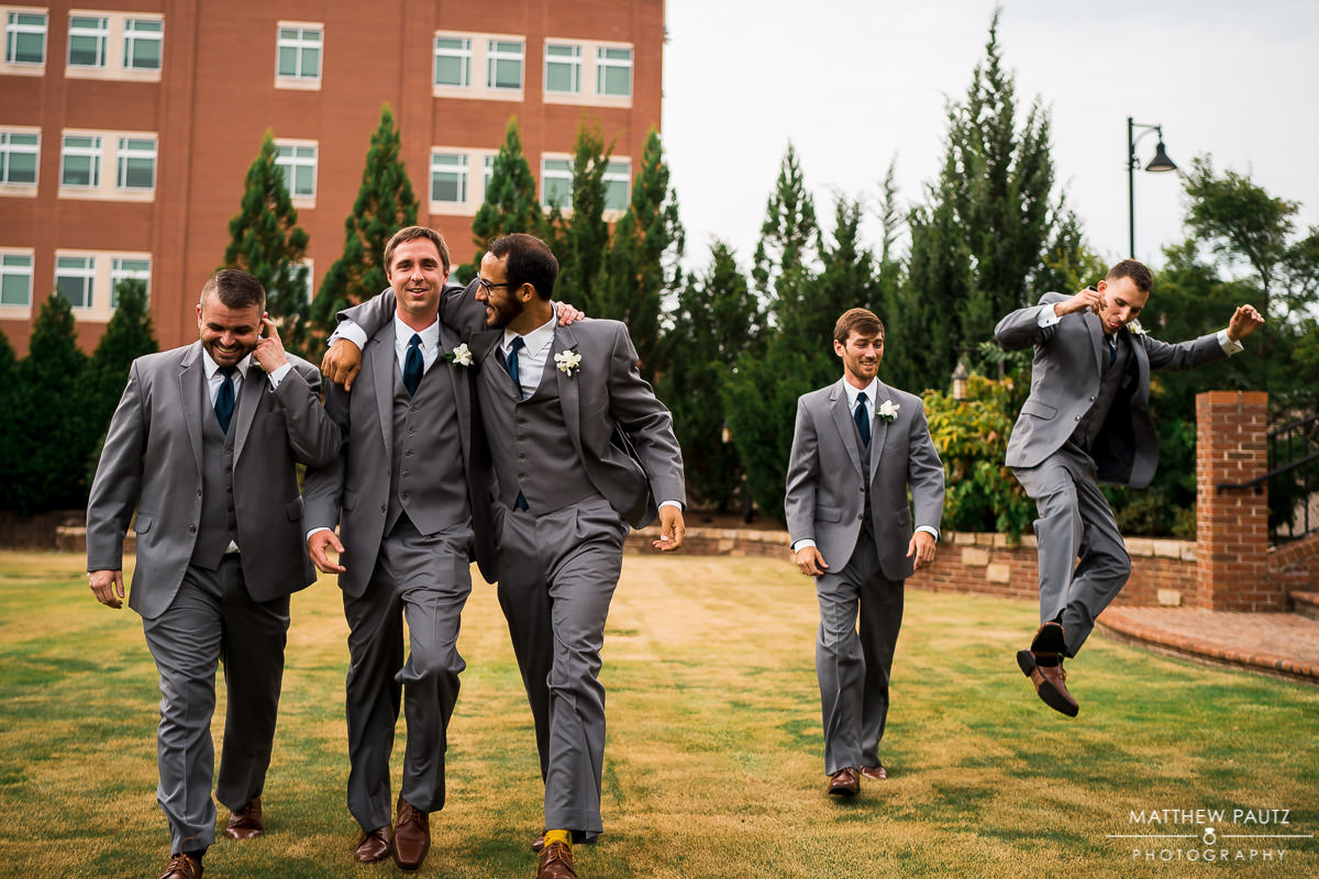 groomsmen goofing off during photos