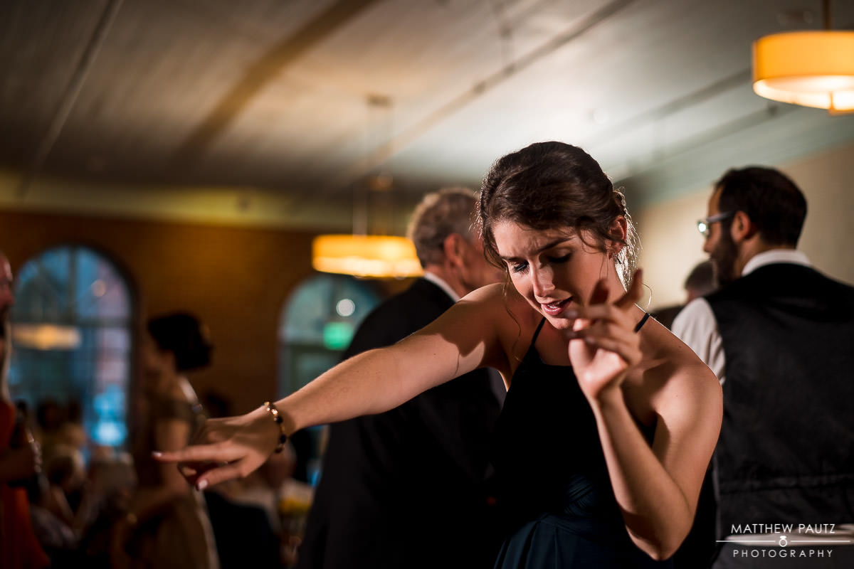 bridesmaid dancing at Indigo hall wedding reception