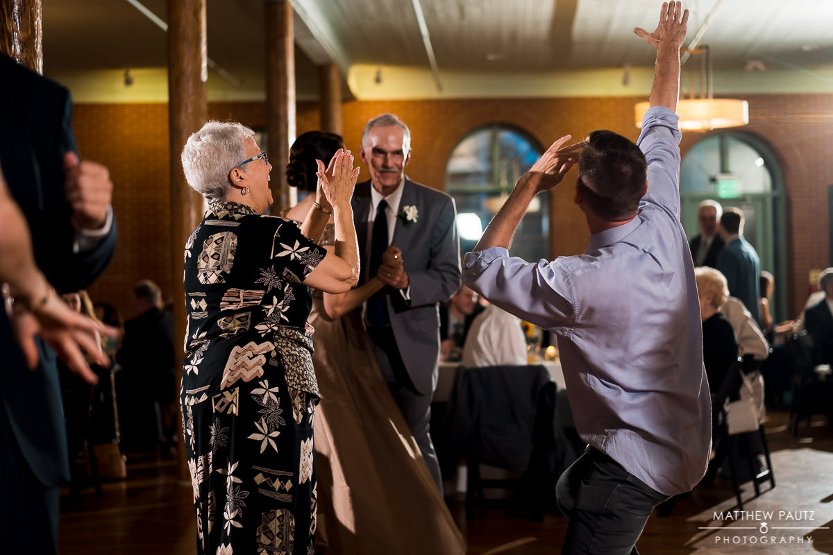 guests having fun and dancing after wedding