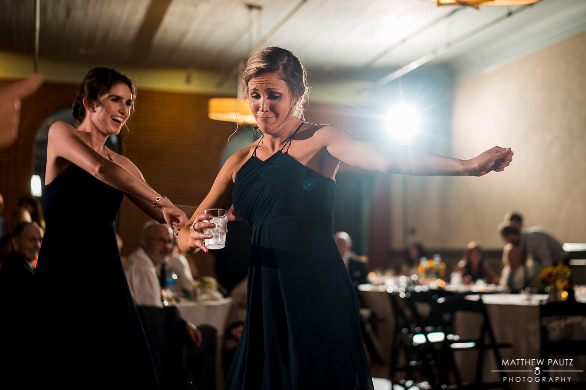 bridesmaids dancing at Indigo Hall wedding reception