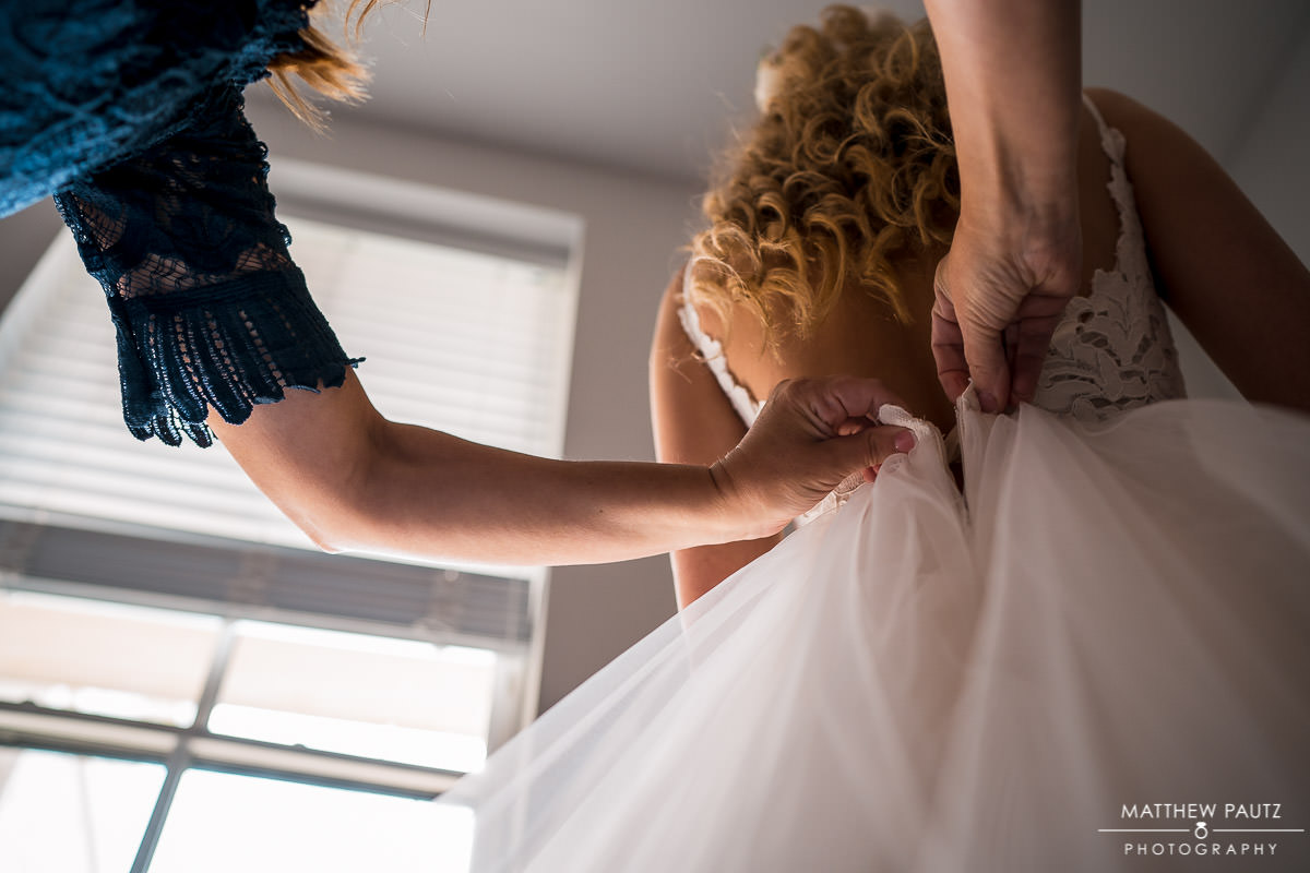 Bride getting dressed before wedding