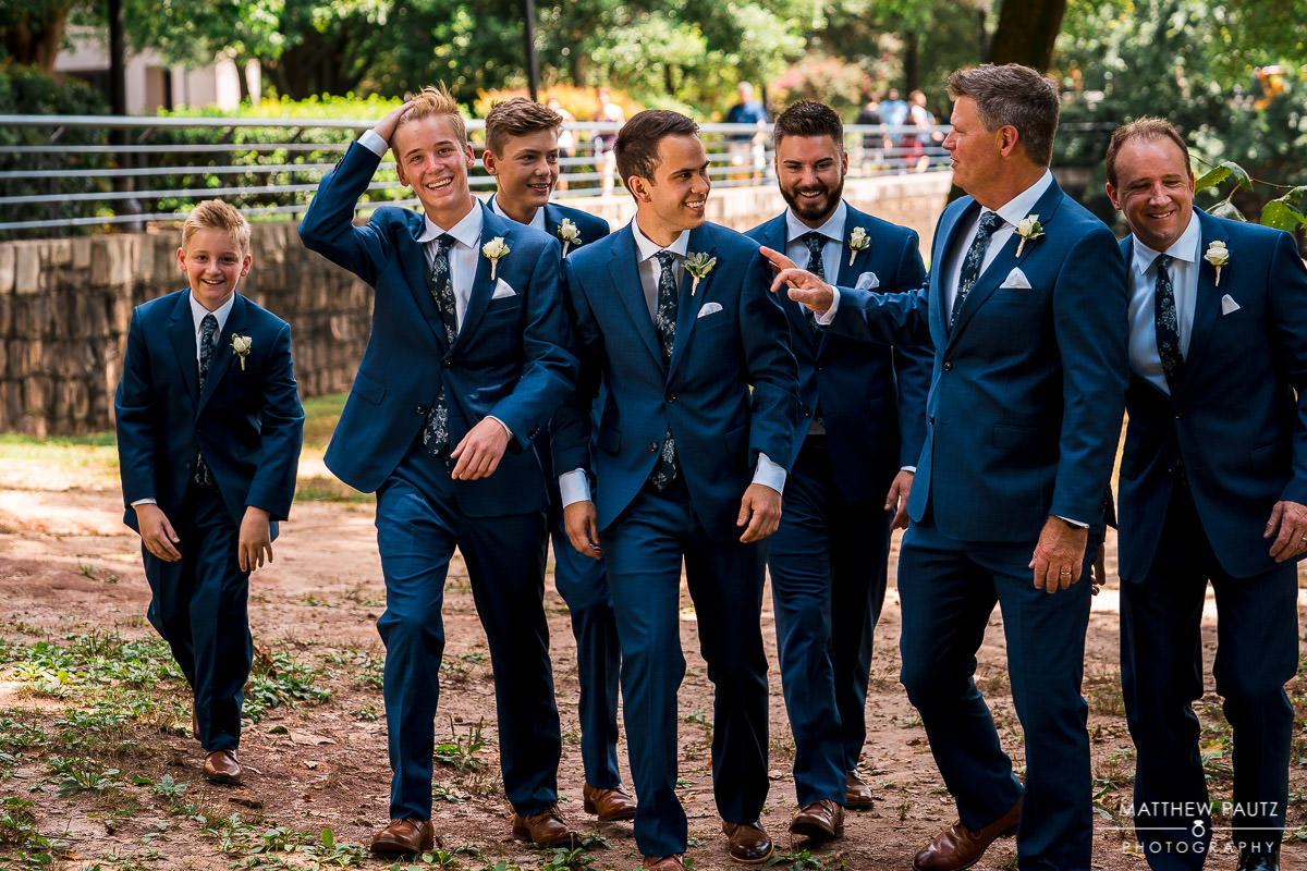 groomsmen walking together in Falls Park