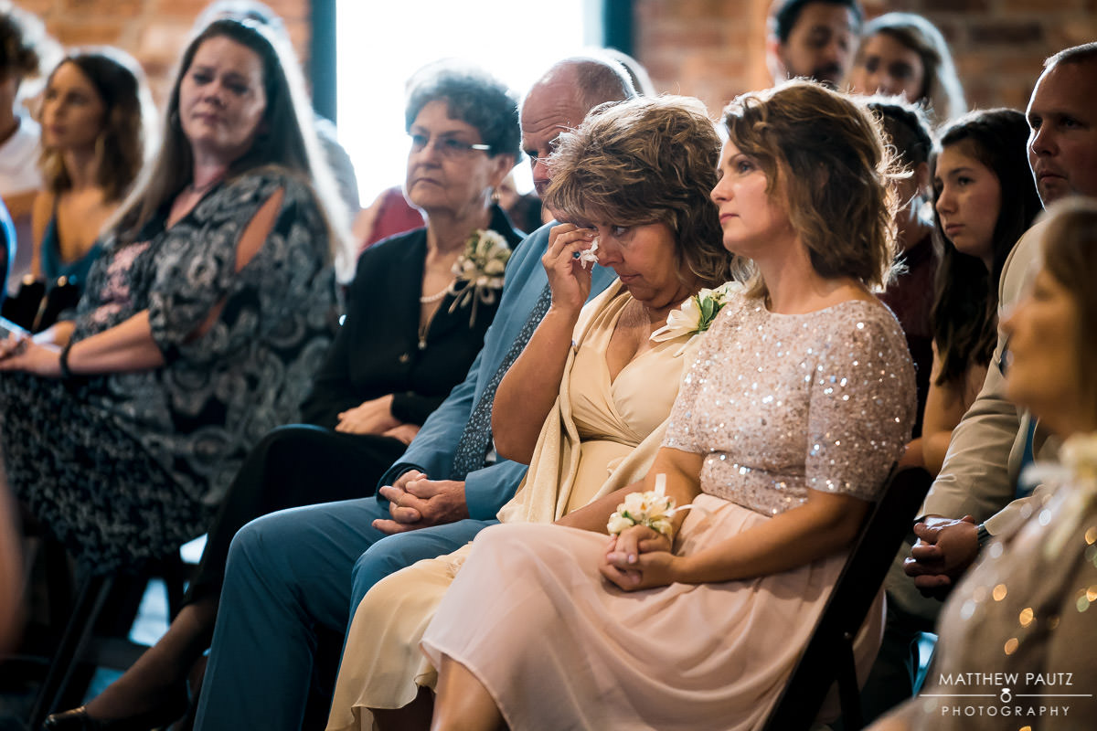 Bride's family crying and reacting to wedding ceremony