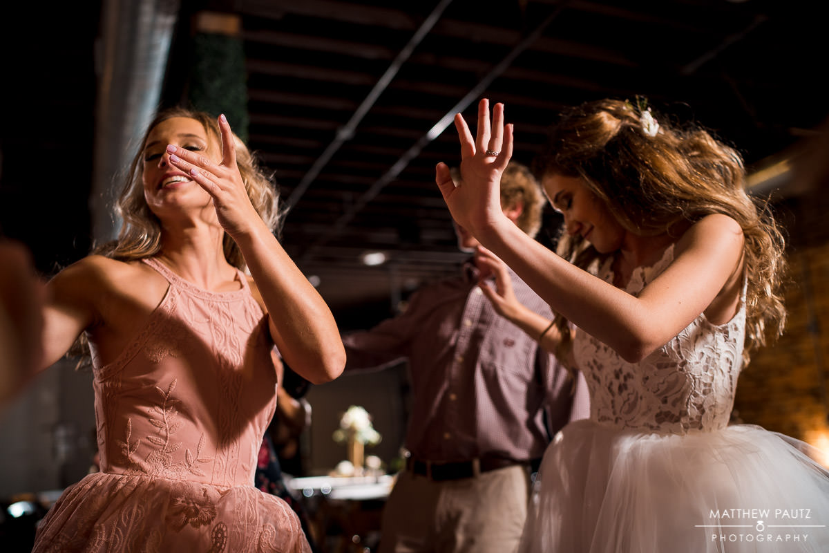 bride dancing with her sister at wedding reception